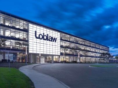 5b7ee62f4637681413cbc7ae_Loblaw Cos Ltd headquarter - Sweeny&Co Architects - P03_LR - exterior closeup entrance dusk
